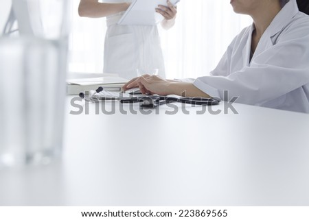 Physician to record data to the computer - stock photo