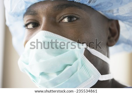 Physician with Surgical Mask - stock photo