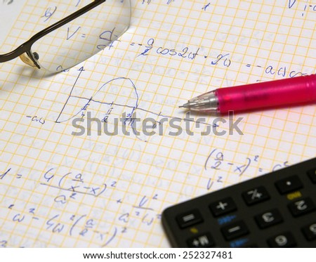 Physics and math exam, study set (hand writing notes, glasses, pencil and calculator