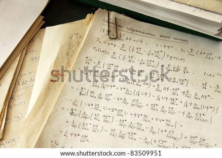 physics formulas and calculations written on paper, quantum hydrodynamics of a single particle - stock photo