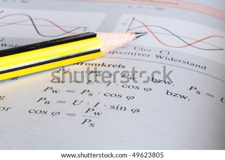 physics science at school with pencil  book and formula