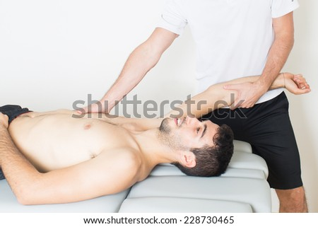 physio-therapeutic arm stretching - stock photo
