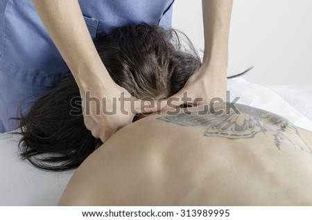 Physiotherapist doing a technique cervical Maitland. Woman patient. PA. - stock photo