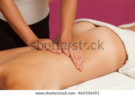 Physiotherapist Giving a Back Massage to a woman with Oil