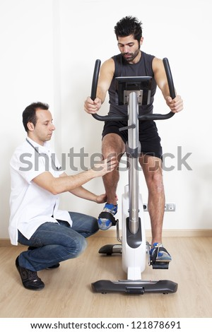 Physiotherapist helping patients with exercise - stock photo