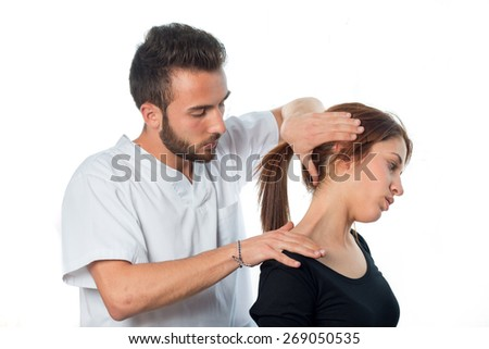 physiotherapist / masseur  doing neck stretching to a young girl isolated on white background - stock photo