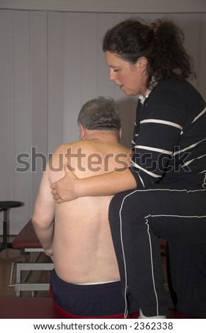 Physiotherapist treating a patient(see more on gallery)