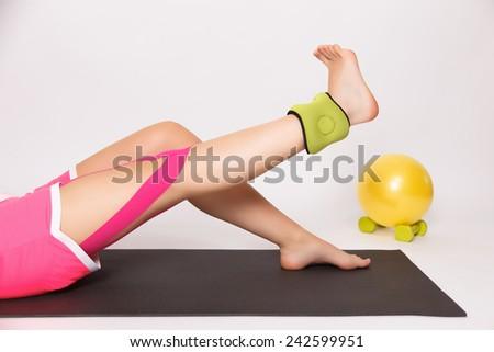 Physiotherapy exercise for leg injury - stock photo