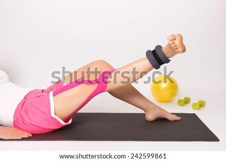 Physiotherapy exercise with kinesio tape - stock photo