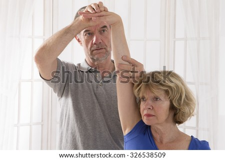 Physiotherapy Senior  woman and physiotherapist - stock photo