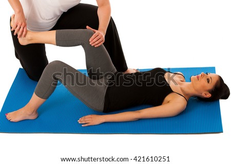 Physiotherapy - therapist doing   leg stretching exercises with a patient to recover  after injury isolated - stock photo