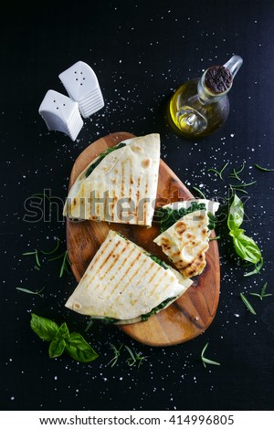 piadina with spinach and mozzarella. Italian healthy snack. street food - stock photo