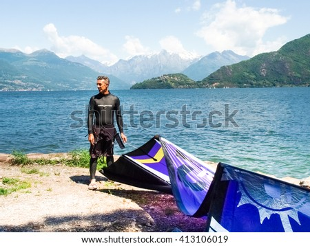 Pianello del Lario, Italy - May 16, 2015: Kitesurfing on the beach while preparing equipment