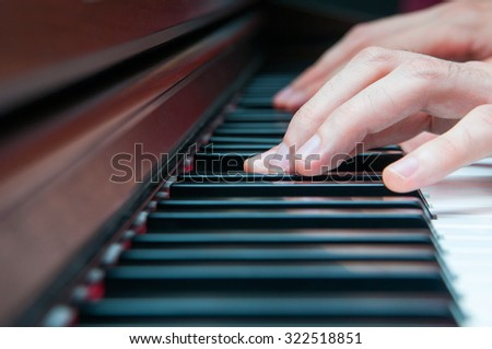 Pianist hands on the instrument - stock photo