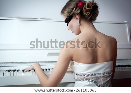 Pianist in the mask - stock photo