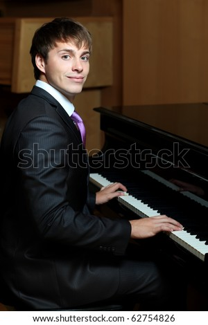 Pianist is playing a piano.