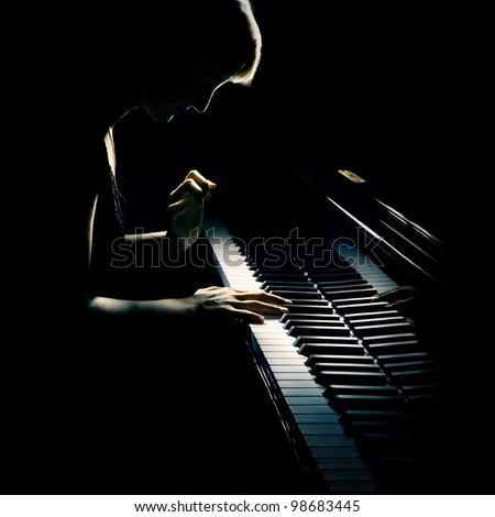 Pianist musician piano music playing. Musical instrument grand piano with woman performer. - stock photo