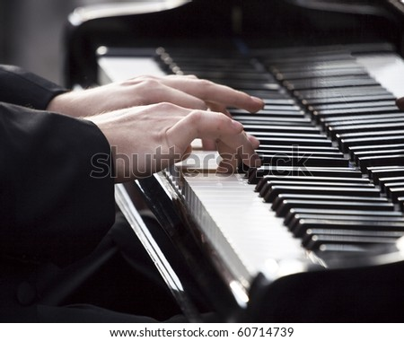 Pianist playing piano at event in memory of Frederic Chopin - stock photo