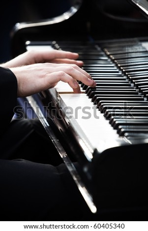 Pianist playing piano in Wroclaw in memory of Frederic Chopin - stock photo