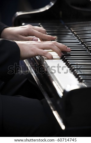 Pianist playing piano outdoors - stock photo