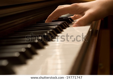 Pianist playing the piano - stock photo