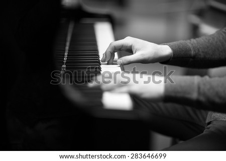 Pianist's hands playing the melody  - stock photo