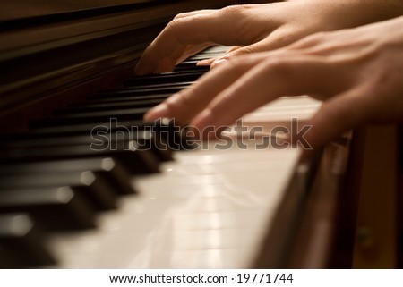 Pianists' hand playing the piano - stock photo