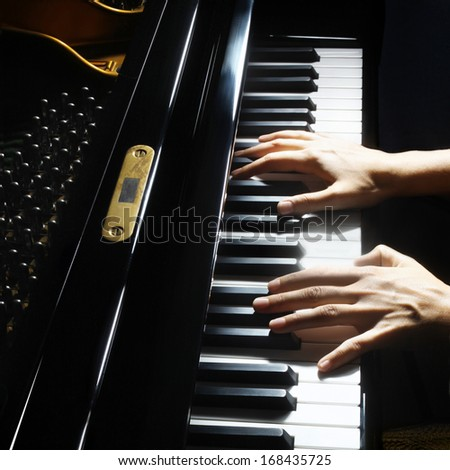 Piano hands pianist playing. Musical instrument grand piano playing details closeup - stock photo