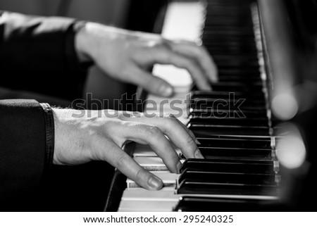 Piano, Human Hand, Piano Key. - stock photo