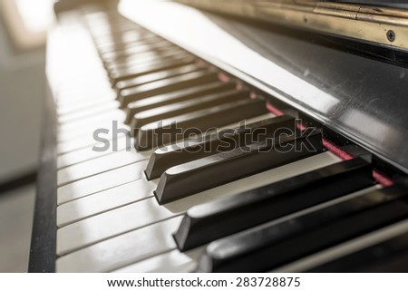 Piano key soft focus with sunshine