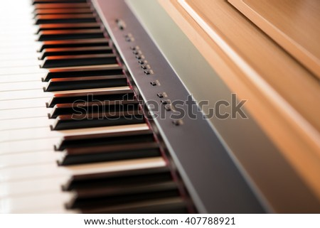 Piano keyboard background with selective focus - stock photo