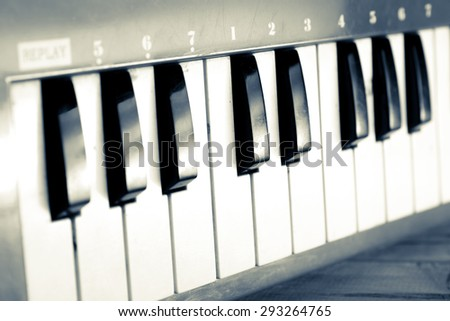 Piano keyboard background with selective focus. - vintage retro picture style - stock photo