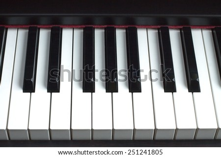 Piano keyboard. Front view closeup - stock photo