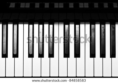 Piano keyboard in black and white - stock photo