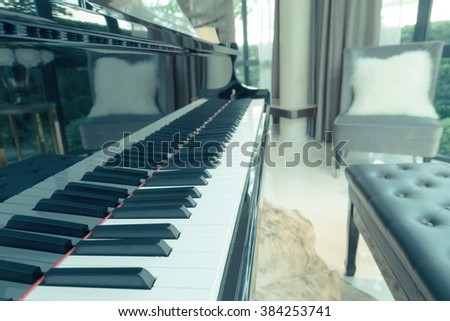piano keyboard in the living room, selective focus and vintage photo - stock photo