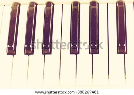 piano keyboard in vintage retro style musical background - stock photo