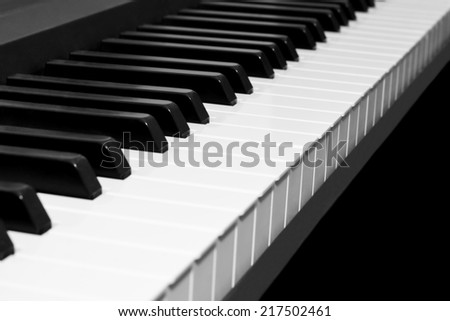 Piano keyboard on white background  - stock photo