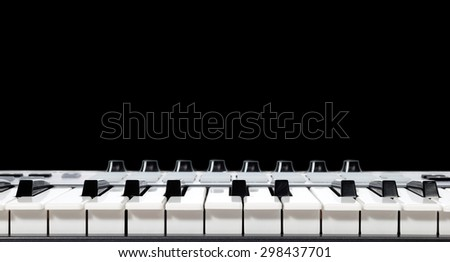 piano, keyboard, synthesizer. isolated on black & copy space for music background