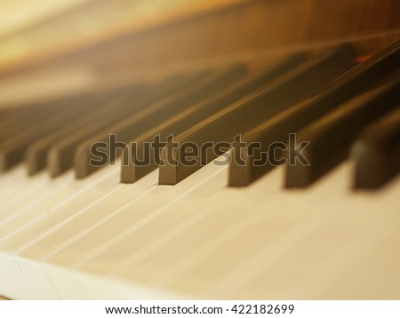 Piano keyboard with selective focus, texture background, warm color toned classic.