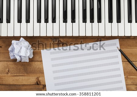 Piano keys and music page - stock photo