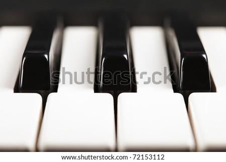 Piano keys closeup photo front view - stock photo