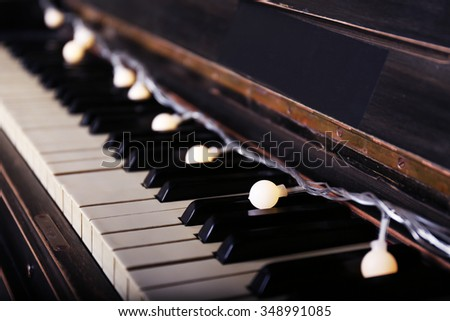 Piano keys decorated with decoration lights, close up