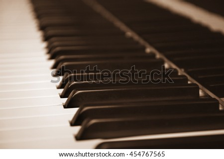 Piano keys in blurred vintage colored photograph - stock photo
