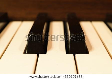 Piano keys in warm color tone, Zoom in - stock photo