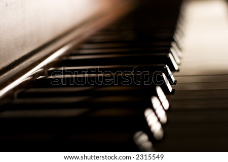 Piano keys on an antique piano - stock photo