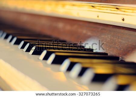 Piano keys selective focus in retro filter effect - stock photo