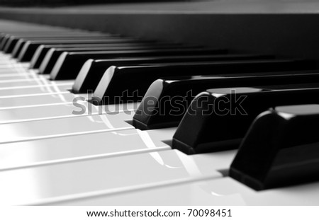 Piano keys side view with shallow depth of field - stock photo