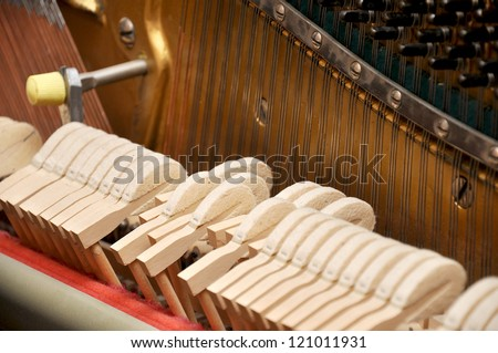 piano mechanism gavel of the string open - stock photo