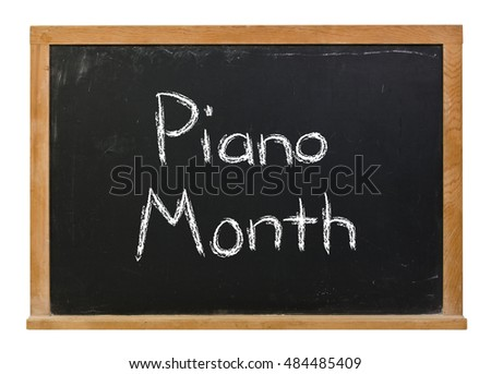 Piano Month written in white chalk on a black chalkboard isolated on white
