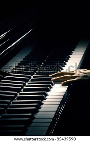 Piano music pianist hand playing. Musical instrument grand piano details with performer hands on black background